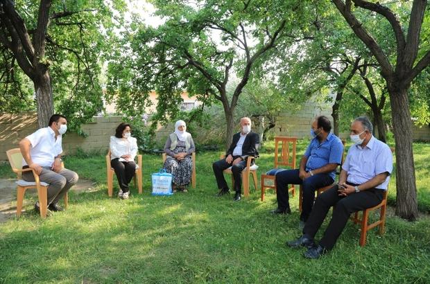 Başkan Akman'dan şehit aileleri ile gazilere ziyaret