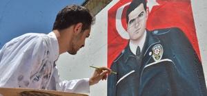 Elbistan'da şehit polisler için özel çalışma Şehit polislerin yağlıboya resimleri, Bölge Trafik Denetleme İstasyon Amirliğinin güvenlik duvarına çizildi