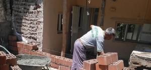 Saruhanlı Belediyesi Büyükbelen'de yaraları sarıyor