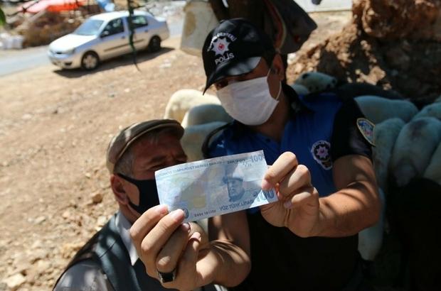 Mardin'de  polis ekipleri kurbanlık satıcılarını sahte para konusunda bilgilendirdi