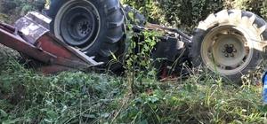 Traktörün altında kalan baba ve oğlunu itfaiye ekipleri kurtardı