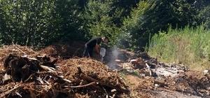 Yakılarak ormanlık alana dökülen fındık atıkları faciaya yol açıyordu Dumanları fark eden vatandaş, kendi imkanlarıyla yangını büyümeden söndürdü