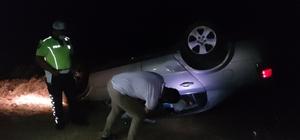 Taklalar atan otomobilden yaralı kurtuldu