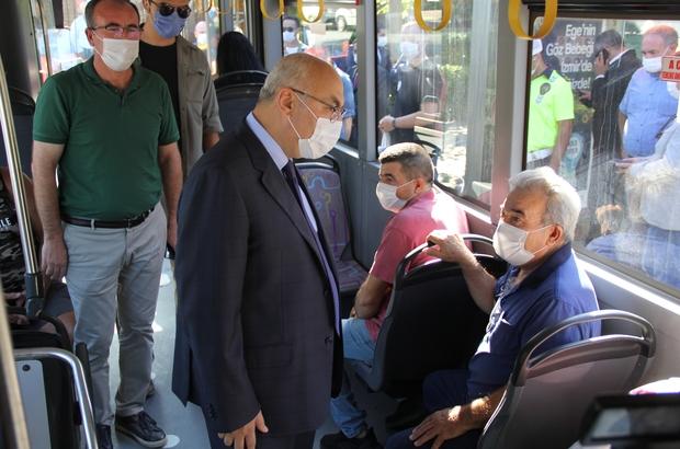 """Vali Köşger: """"Konak ilçesinde özel bir mesai uygulamasına geçeceğiz"""" Toplu taşıma araçlarında denetim yapan İzmir Valisi Köşger: """"Konak'ta 28 bin çalışan var, 28 bin çalışanın 14 bini saat 8'de, 14 bini saat 9'da mesaiye başlayacak"""""""