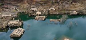 Isparta'da sular altında kalan köy evlerinde seyirlik görüntüler