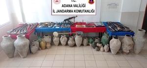 Tarihi eser operasyonundan cephanelik çıktı Adana'da tarihi eser kaçakçılığı yaptığı belirlenen 3 kişi kaçak kazı yaparken suçüstü yakalandı Evlerinde Kalaşnikof tüfek, el bombaları, mayın, tüfek bombası ve roket gibi çok sayıda mühimmat çıkan şahıslardan biri hakkında FETÖ/PDY üyeliğinden işlem başlatıldı