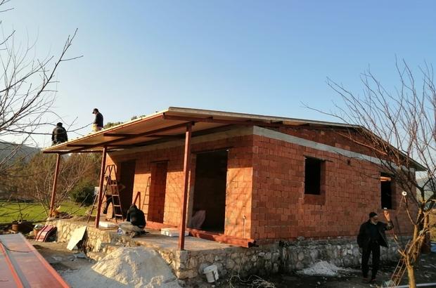 Yangında evleri kül olan çiftin, yeni evinin yapımına başlandı