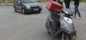 Kurye motosikleti ile otomobil çarpıştı: 1 yaralı