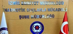 İzmir'de uyuşturucu satıcılarına darbe: Bir araçta 26 kilo bonzai ele geçirildi İzmir polisinden zehir tacirlerine darbe