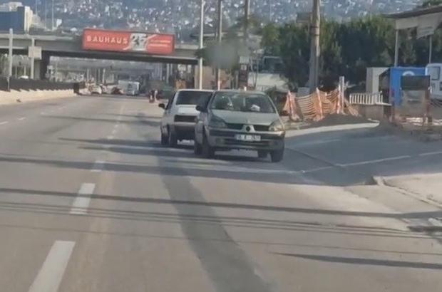 Bursa'da şaşkına çeviren görüntü...Arızalı otomobili kara yolunda ters çekti