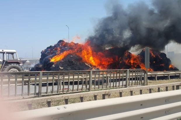 Saman yüklü traktör alev alev yandı Yangını söndürmek isterken römorktan düşen sürücü ağır yaralandı
