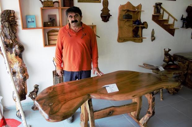Ceviz ağacından çıktı, fiyatı yarım milyondan fazla Sivas'ta kurt figürlü masa görenlerin dikkatini çekerken, fiyatıyla da dudak uçuklatıyor