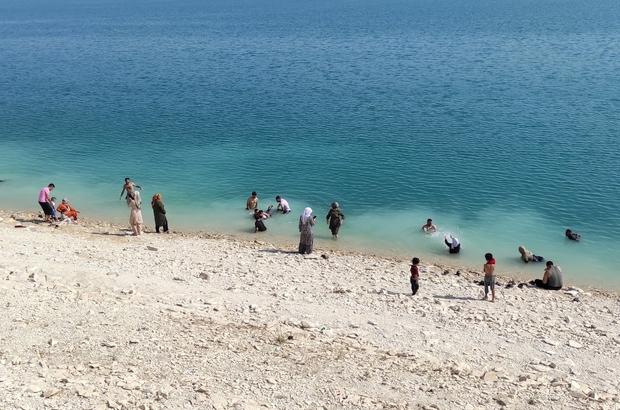 Artan boğulma vakalarına rağmen barajda serinlediler