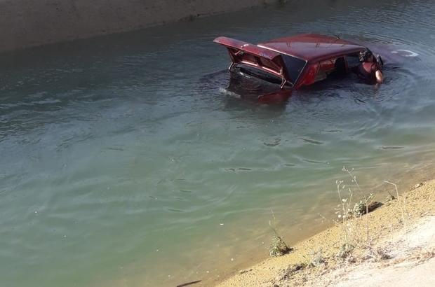 Otomobil kanala uçtu, 2 kişi ölümden döndü