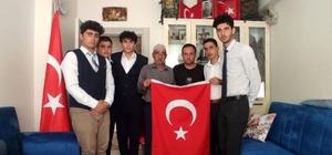 Ülkü Ocaklarından şehit ailelerine Türk bayrağı hediyesi