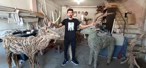Lodosun sürüklediği dalları sanata dönüştürüyor Lodos esintisiyle kıyıya vuran dalları hayvan heykellerine dönüştürdü