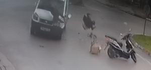 Kaza yapan motosikletteki güvercinler böyle havalandı 2 kişinin yaralandığı kaza ve güvercinlerin havalandığı anlar saniye saniye güvenlik kameralarına yansıdı